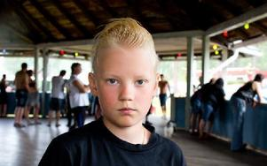 Hjalmar Lindehag, 11 år, Kiruna– Det är kul. Det är mycket bilar och band som spelar. Foto: Sofie Lind