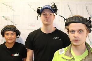 Tre unga byggarbetare som har fullt schema, just nu med ombyggnaden av ett hotell i Borlänge; f v Sofia Johansson, Joakim Isaksen och Linus Norström.