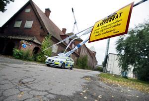 Polisens avspärrningar kring Kraftverksgatan den 23 september 2012 då liket upptäckts. Arkivbild.