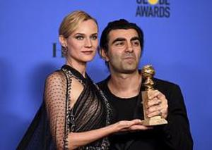 Diane Kruger och Fatih Akin med Golden Globe-statyetten.
