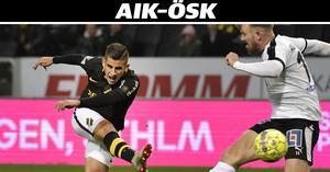 AIK:s Stefanelli drar i väg ett skott förbi Michael Almebäck.