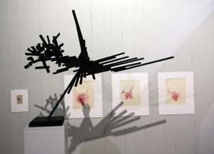 Skulptur med några av de föregående skisserna.