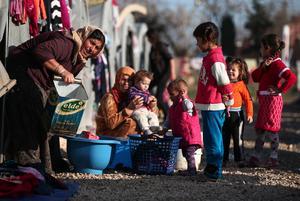 Syriska flyktingar i ett tältläger i Turkiet. Foto: Emrah Gurel/AP Photo