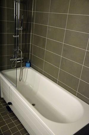 Quality Hotel. Badrummet är utrustat med ett badkar.