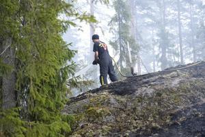 Brandman i arbete under den stora branden.