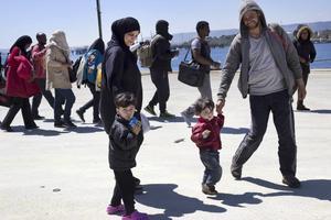 Migranter vid Medelhavet.