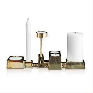 Collage är en ljusstake som kombinerar kronljus, blockljus, värmeljus. Design Folkform. Pris 2 998 kronor hos www.skultuna.com.