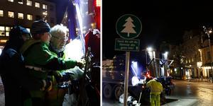 Sexåriga Knut Limskog fick hjälp av pappa Martin Zötterman med att trycka på rätt knapp för att bli av med årets gran,  när kommunens Lennart Wallbom samlade in örebroarnas juleträd.
