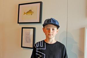 Tioårige Lukas Eriksson ställde ut sina djurmotiv tillsammans med pappa och syskonen.