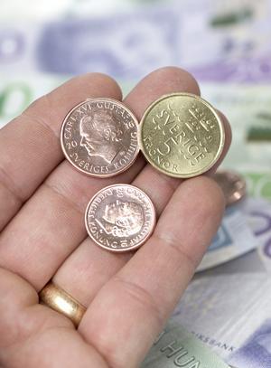 Två kronor växte snabbt i avgiftskarusellen. Foto: Fredrik Sandberg / TT /