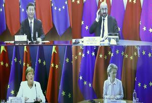 EU sluter ett investeringsavtal med Kina. Men Kina fortsätter att stänga ute europeiska företag och koncentrationslägren i Kina fortsätter att fyllas av uigurer, skriver Bernard Guette, ledamot i Europaparlamentet. På bilden: Ett elektroniskt toppmöte mellan Kina och EU.