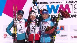 Prispallen i damsprinten med vinnaren Tiril Udnes Weng i mitten. Foto: www.jwsc2018.ch