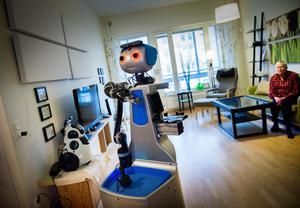 En robot hjälper till att hämta medicin.