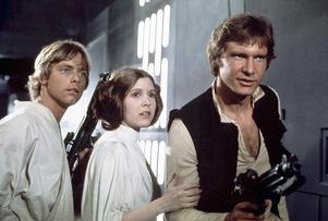 Luke Skywalker (Mark Hamill), prinsessan Leia (Carrie Fisher) och Han Solo (Harrison Ford) i George Lucas