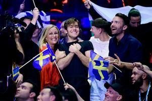 Sveriges Benjamin Ingrosso (mitten) under omröstningen under lördagens final i Eurovision Song Contest på Altice Arena i Lissabon.Foto: Stina Stjernkvist / TT