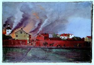 Kalabaliken den 10:e juli 1869 illustreras här i en oljemålning från en okänd konstnär som tillhör Carl Larssons fotosamling. Den visar stadens yttersta utposter mot norr i hörnet av Byggmästare- och Staketgatorna.