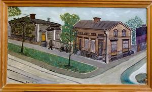 Hörnet Brynäsgatan och Tredje tvärgatan. Här fanns förr en tobakshandel och en skofabrik. Vänder man på tavlan ser man att den är målad på grön/vitrandig markisväv!