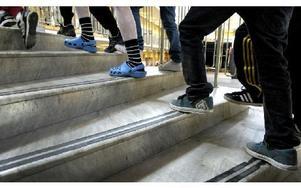 Elever i en skola på väg uppför en trappa. Foto: JANERIK HENRIKSSON / SCANPIX