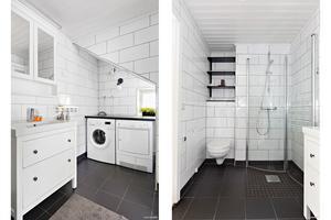 Kaklat badrum med tvättmaskin och torktumlare.