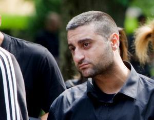 Dany Moussa på sina bröders begravning.