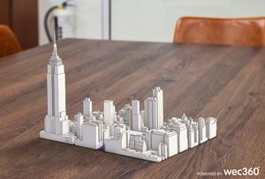 En av de möjligheter som 3D-tekniken från WEC360° erbjuder, en modell av Manhattan placerad på bordsskivan.  ILLUSTRATION: WEC360°