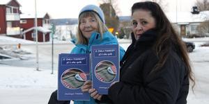 Gunilla Ojala och Ingela Dahlin från Storöringens fiskeklubb med den unika receptbok som klubben tagit fram.
