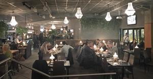 Matsalen, eller brasseriet som Interpool säger själva, är avgränsat från resten av lokalen med prunkande växtlighet.