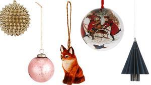 Gnistrande julgranskula från Åhléns och pastellrosa kula från H&M Home. Räven och den gammaldags kulan kommer från Åhléns och granen av vikt papper från Jotex.