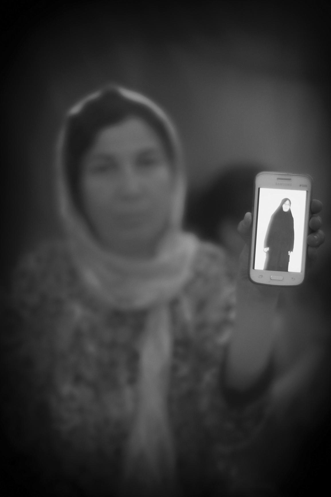 Fotograf bortford av irakisk polis