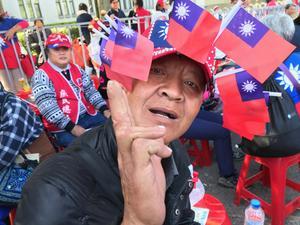 Taiwan är en av Asiens bäst fungerande demokratier. På bilden: en manifestation med anhängare till oppositionspartiet Kuomintang.