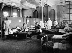 Alf Ronny ser förklaringar till att coronaviruset fått så enorm uppmärksamhet. Bilden  är från 1918 från det provisoriska spanska sjukhuset där patienter drabbade av  den dödliga  Spanska sjukan behandlades.