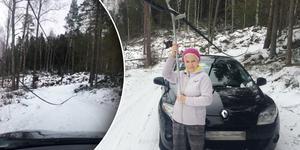 Karin Tengvald har tillsammans med Casten von Otter lyft bort telekablar från vägen där de bor utanför Edsbro. OBS! Du ska som privatperson aldrig röra nedfallna ledningar, det kan innebära en fara för liv.  Foto: Privat