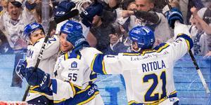 Wännström, Ahnelöv och Ritola firar. Foto: Daniel Eriksson / BILDBYRÅN.
