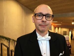 Magnus Hansson är ceremonimästare och docent i företagsekonomi. Han ser till att hela den traditionstyngda akademiska högtiden går som den ska.
