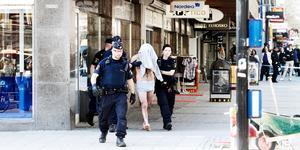 Rånaren leds ut av polisen i bara kalsongerna efter det misslyckade rånförsöket.