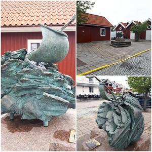 """Richard Brixels skulptur """"Hemfärd"""" står inklämd bakom röda bodar i Askersunds hamn.Foto: Mats Berganm"""