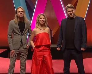Niklas Eklund, Frida Öhrn och Hampus Eurenius under presskonferensen inför Melodifestivalen 2020. Foto: Frysbild SVT
