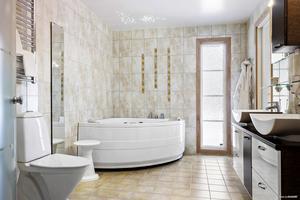 Modernt och stort badrum med jacuzzi Foto: David Håkansson