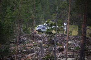 Helikoptrarna fortsatte under torsdagen att vattenbomba området.