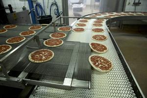 tre pizzor i sekunden gräddas