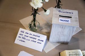 En plats i kyrkan för tunga tankar efter mordet. Alldeles i närheten förlorade en man i 25 års åldern sitt liv.