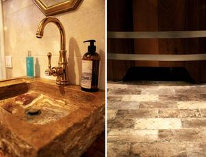 Handfatet och golvet är gjorda i vacker sten.