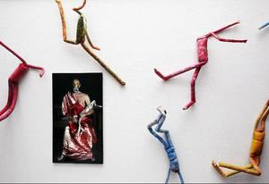 Världsspermier (en förvrängning av ordet världspremiär) dansar runt på väggen. De har namn från jordens alla länder. I mitten verket