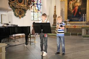 Axel person och Tofte Solum på trumbon och trumpet.