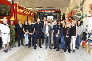 Justitieminister Morgan Johansson på plats i Älvdalen tillsammans med representanter från de som var engagerade i arbetet runt branden på Älvdalens skjutfält.