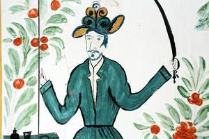 Den målade dörrvakten i Ol-Andersgårdens herrstuga heter Knut. Knut Knutsson från Antikrundan dök upp precis när Gun-Marie berättade om dörrvakten för en grupp.