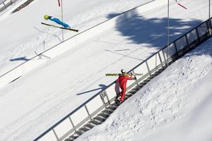 Anders Gustafssons på väg uppför trapporna i Lugnets K90-backe.