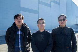 Wang Jianlin, Song Jia Feng och Zhu Jingming som alla ingår i projektledningen för National speed skating oval i Beijing, Kina.