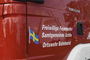 Tyska brandbilar med svenska flaggor, efter insatsen i Särna.