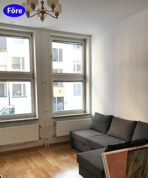 FÖRE: En sparsamt möblerad övernattningslägenhet med stora fönster ut mot gatan. Foto: Lina Bergroth